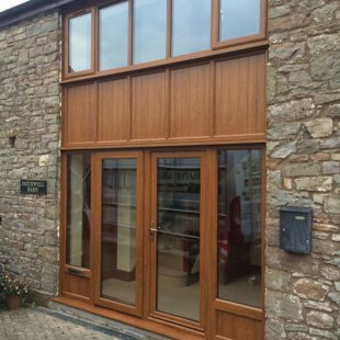 Double Height Barn Conversion Screen with Doors After in Duraflex PVCu Antique Golden Oak