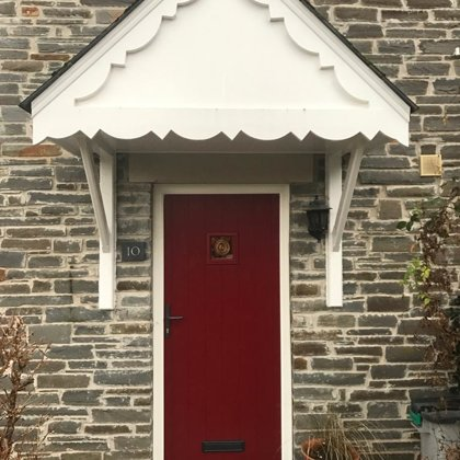 Traditional Red Cottage Door with Textured White Frame installed in Llangattock for the Pu