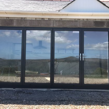 The Abbott-Swift, Gilwern 4 Section Wide-Span Bi-Folds overlooking the Sugarloaf Mountain