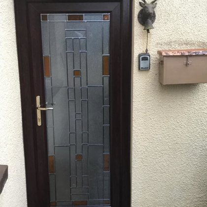 Bespoke lead and stain design created and installed for the Smith family of Llanelly Hill