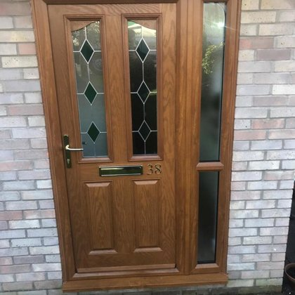 Antique Oak PVCu Door with Side-Screen and Bevels installed for the Greens of Tregare